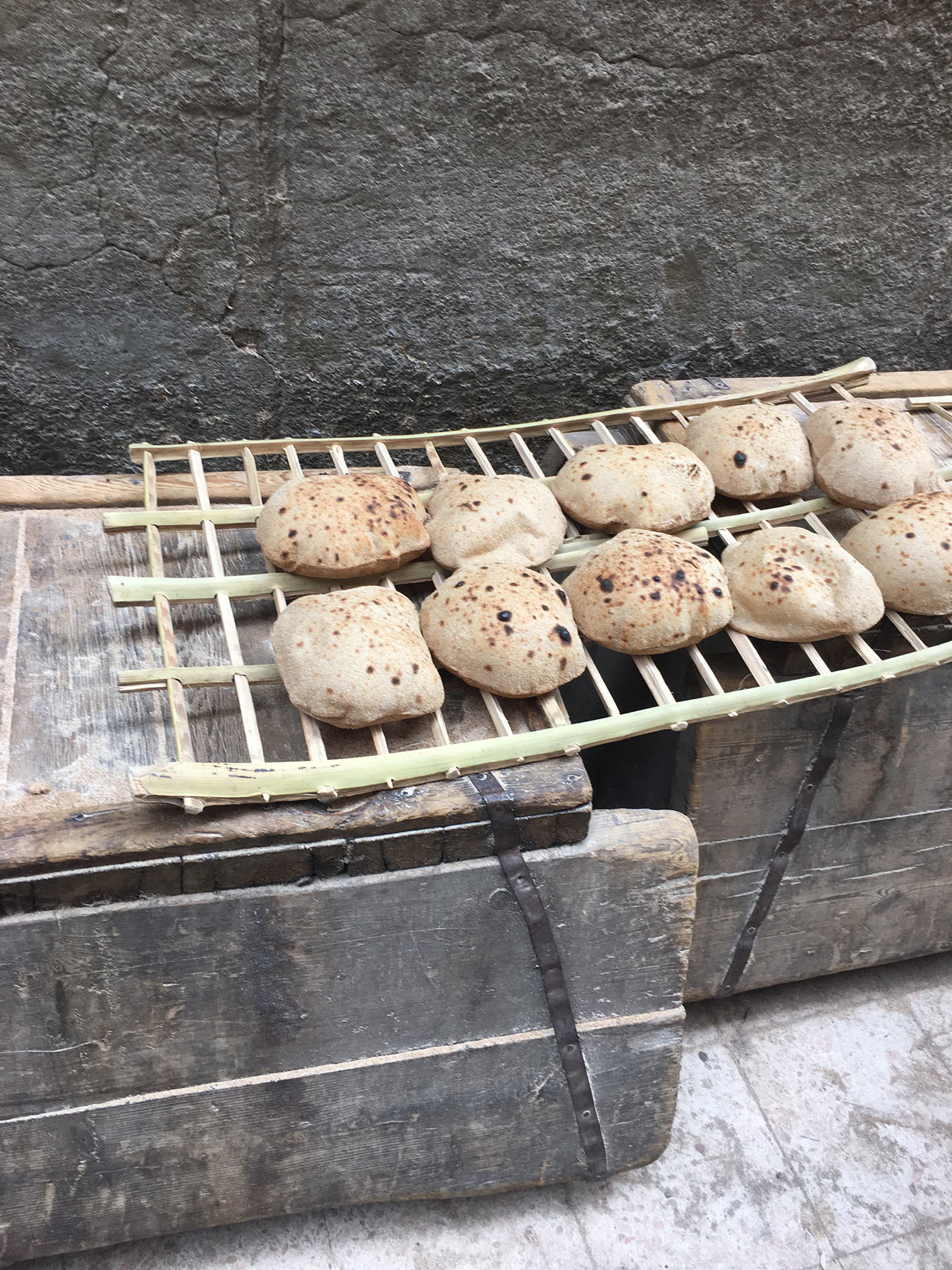 Hot bread on a rack. Photo by Mariam Taher.
