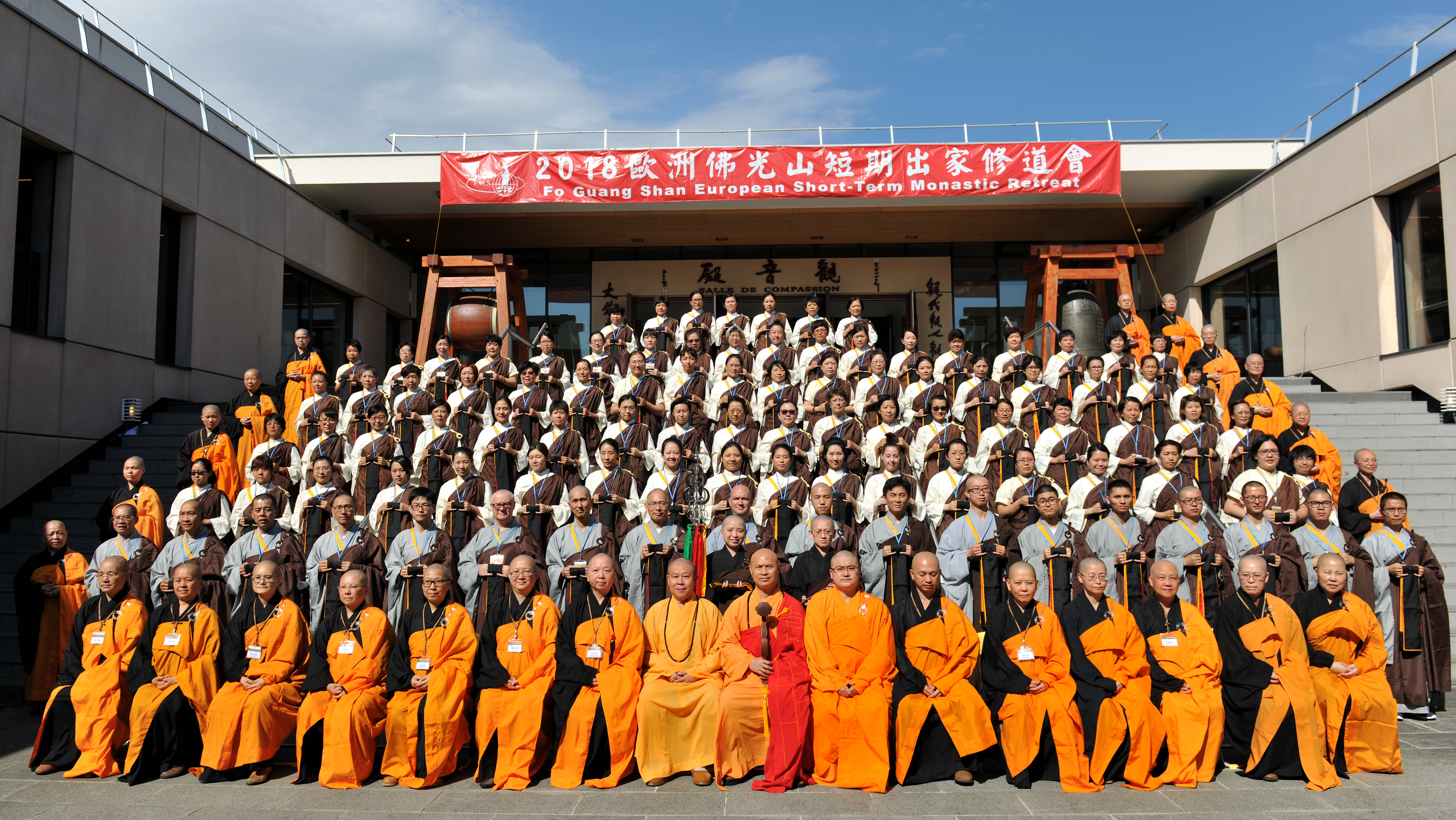 Preceptees and monastics pose for a group photo after the conferring the precepts ritual, Fo Guang Shan European Headquarters, 2018. Photo by Life News Agency.