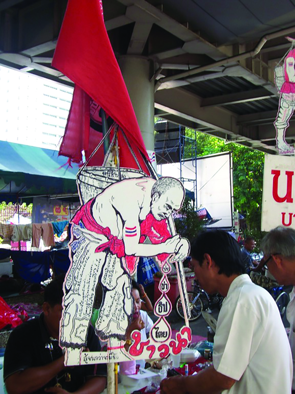A banner depicting a farmer's burden and quest for democracy. The picture was taken during the 2010 Red Shirt protest. Photo by Bo Kyeong Seo.