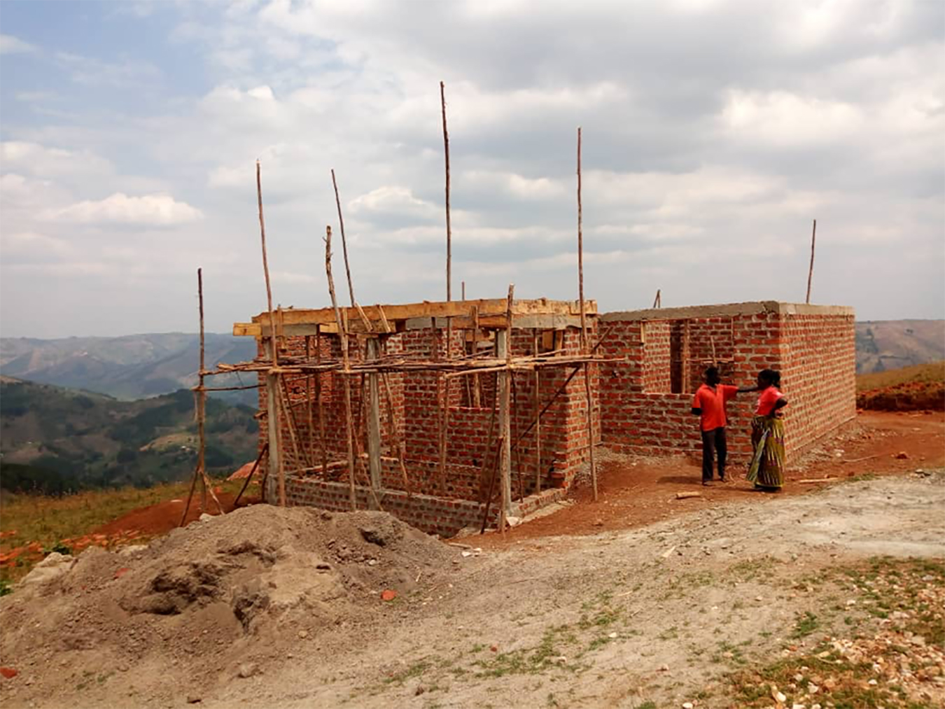 A small, half-built, brick house on the outskirts of Mbarara. This modest construction project was already two years in the making when this photo was taken. Photo by Twesigye Pius.