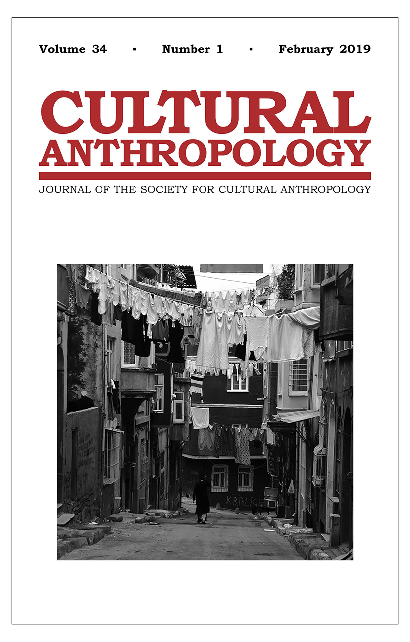 Cover of the February 2019 issue, featuring a black-and-white photo of a narrow street in Turkey.